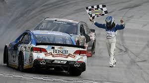 Kevin Harvick heads over to celebrate the win with his team owner and boss Tony Stewart. Photo credit to www.sportingnews.com
