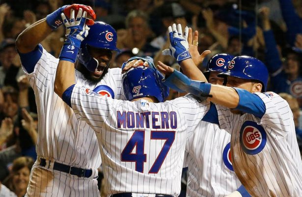 Miguel Montero provided a grand moment in the Cubs game 1 victory. Photo credit to si.com