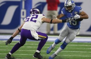 WR Golden Tate hauls in crucial catch against LB Chad Greenway. Photo credit to freep.com